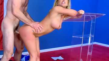 Fake-titted blonde Cherie Deville gets boinked against the background of the big flag by Charles Dera